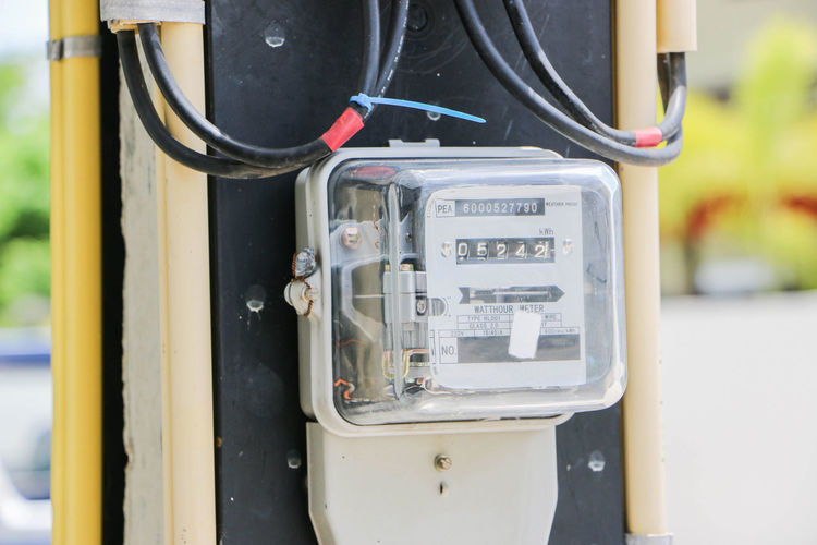 Close-up of electric meter outdoors