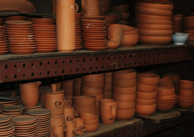 hardened clay Abundance Arrangement Art And Craft Business Ceramics Choice Craft For Sale Hardened Clay Indoors  Large Group Of Objects No People Order Pottery Retail  Retail Display Sale Shelf Small Business Stack Still Life Store Variation