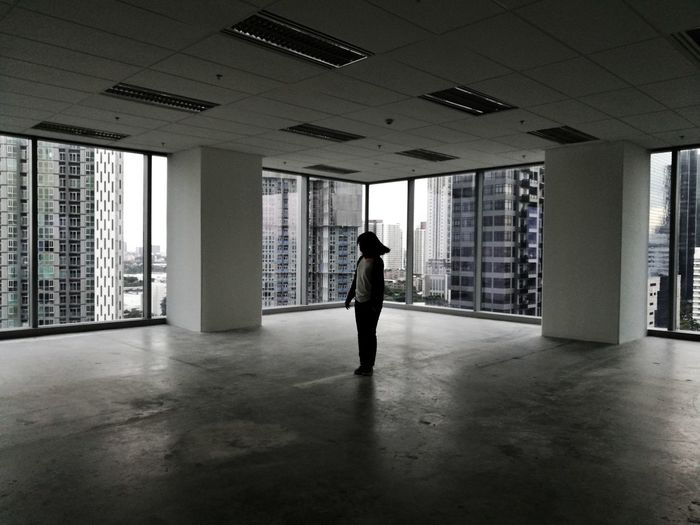 Silhouette Indoors  Indoor Office Office Office Building Architecture Built Structure One Person People Standing Shadow Modern City Day