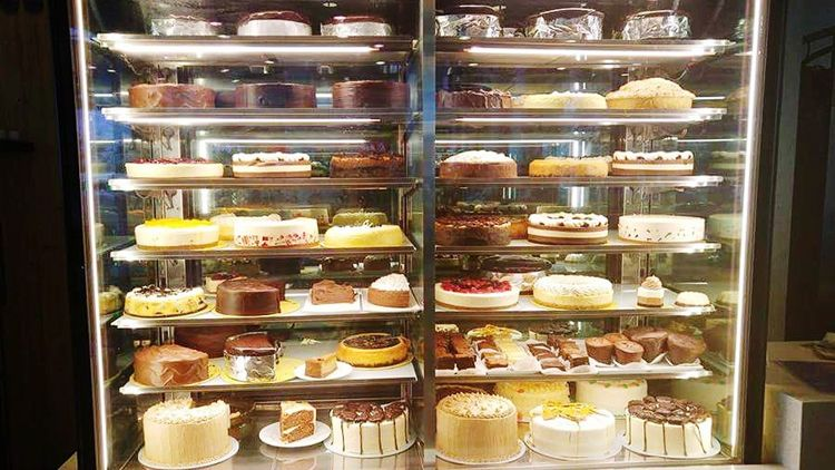Sweet Food Variation Dessert Indulgence Store Bakery Retail  Unhealthy Eating Food Choice Display Cabinet Cake Retail Display Food And Drink Temptation Shelf Abundance Baked Store Window Consumerism