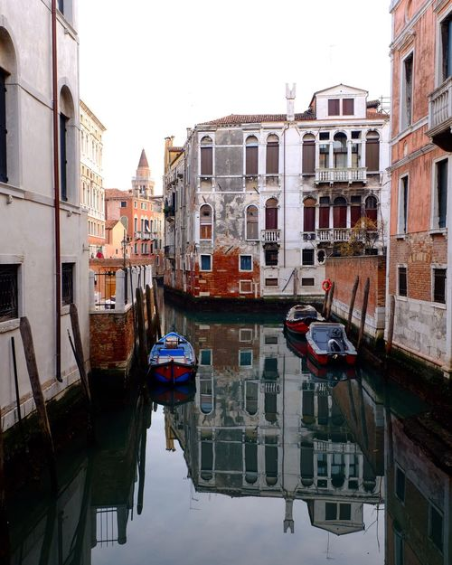 Adapted To The City Canal Building Exterior Cultures Architecture Gondola - Traditional Boat Built Structure Reflection Moored Water Travel Destinations Transportation Mode Of Transport Nautical Vessel No People Outdoors City Day Gondolier