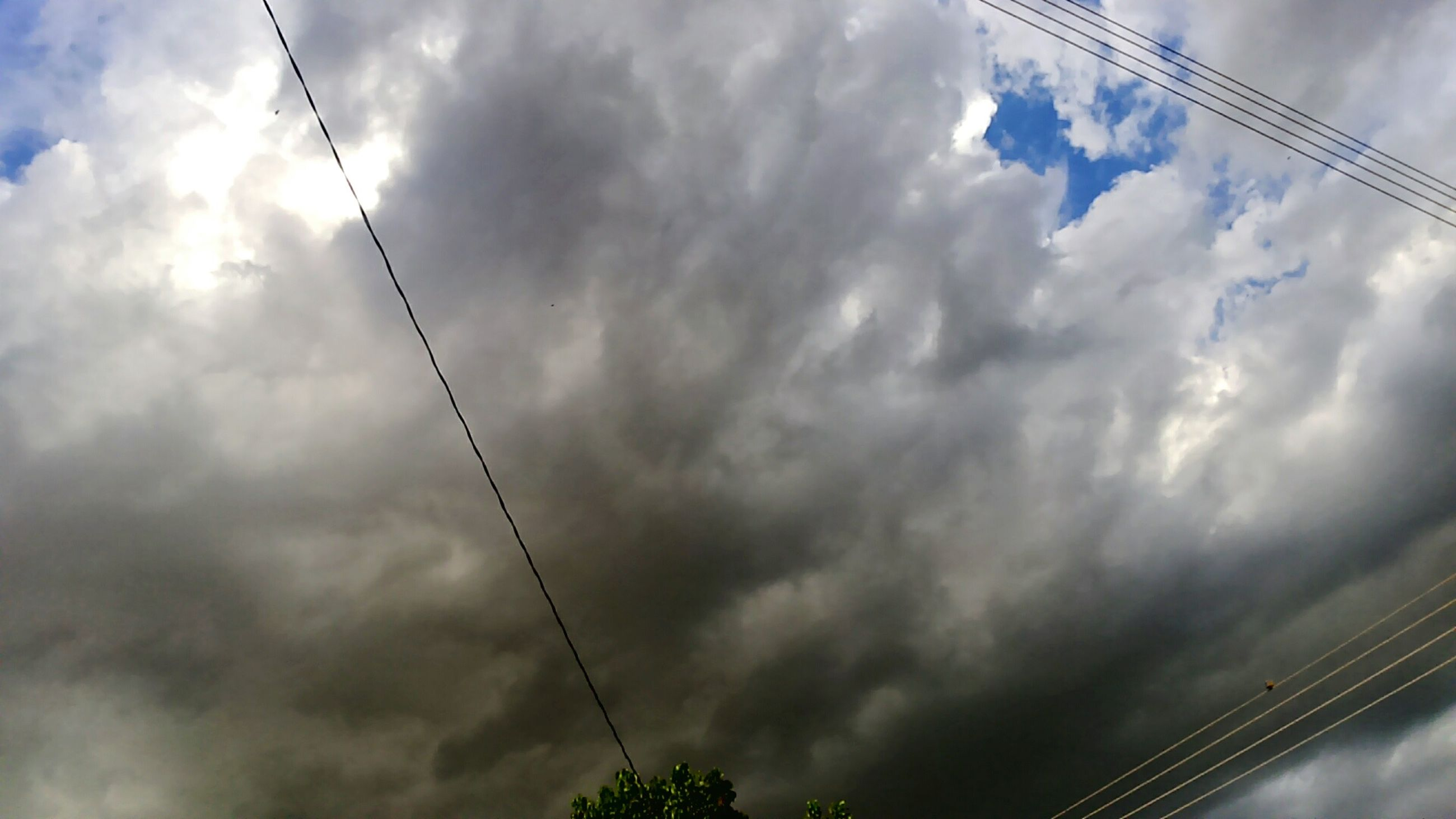 sky, power line, low angle view, cloud - sky, cloudy, cable, electricity, electricity pylon, power supply, connection, cloud, weather, overcast, technology, nature, power cable, beauty in nature, fuel and power generation, silhouette, cloudscape