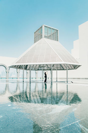 Sky Built Structure Architecture Real People Building Exterior One Person Clear Sky Nature Water Day Lifestyles Full Length Reflection Rear View Swimming Pool Men Outdoors Leisure Activity
