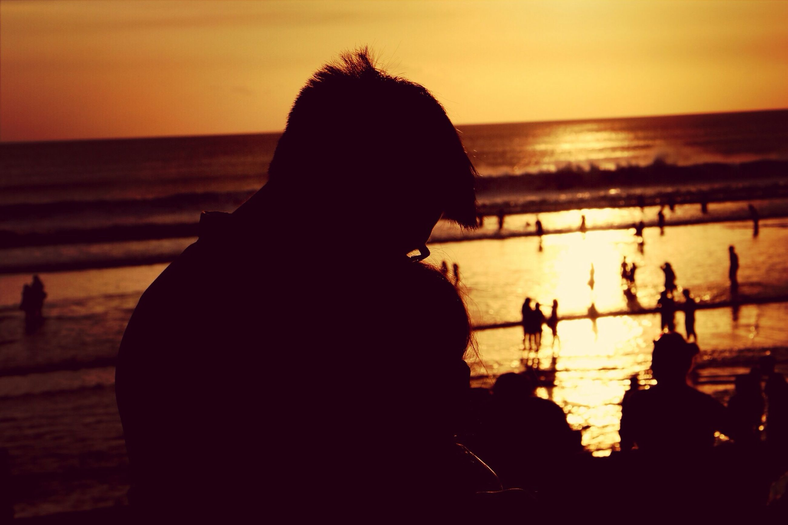 sunset, sea, water, silhouette, horizon over water, beach, orange color, leisure activity, lifestyles, person, shore, sky, scenics, men, beauty in nature, sun, idyllic, tranquil scene, tranquility