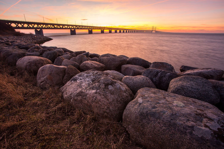 Öresund Bridge øresund Bridge Öresund Bridge Sunset Water Sky Sea Rock Connection Nature Architecture Rock - Object Scenics - Nature Solid Built Structure Bridge Cloud - Sky Beauty In Nature Bridge - Man Made Structure Tranquil Scene Tranquility Transportation No People Outdoors