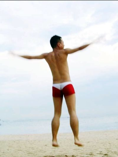 The Great Outdoors With Adobe Outdoor Photography Beachphotography Sunny Flying High Taking Photos That's Me Scenery Shots Sea And Sky Photooftheday Smartphonephotography Singapore Sentosa Island, Singapore Red And White Swim Suit Speedo Fun Levitating