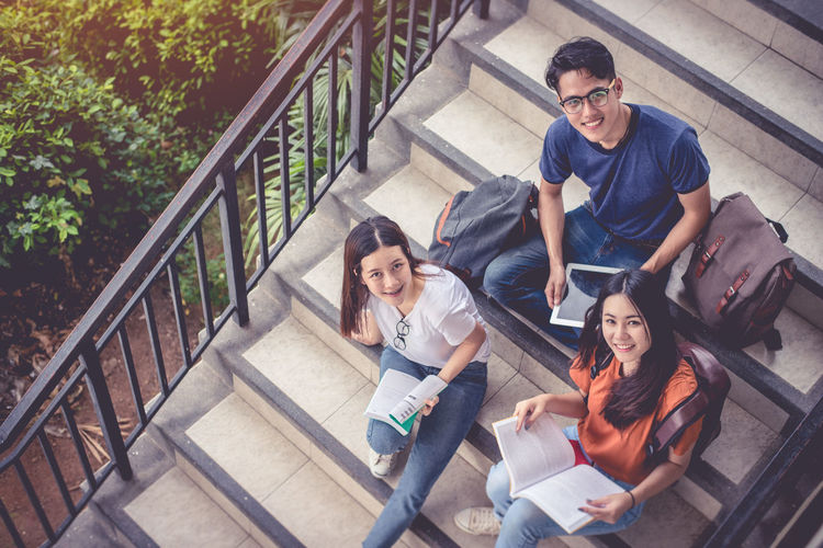 Adult Beautiful People Campus Cheerful Education Group Of People Happiness High Angle View Learning Lifestyles Looking At Camera Men Portrait Railing Smiling Staircase Steps Steps And Staircases Student Togetherness University University Student Women Young Adult Young Women Press For Progress Press For Progress