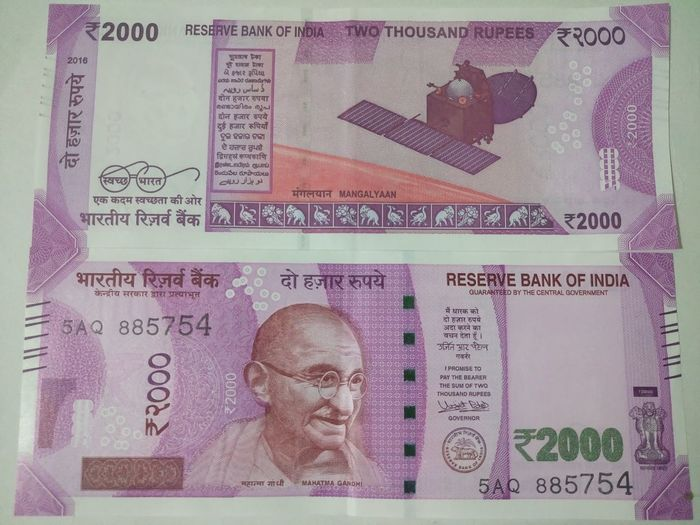 Indian two thousand rupee note 2000 Adult Adults Only Analyzing Banknote Business Currency Indian Finance Finance And Economy Futuristic Indian Culture  Indian Currency Indian Two Thousand Rupee Note Men New One Man Only One Person Only Men Paper Currency People Pink Color Savings Success Two Thousand Rupee Note Wealth