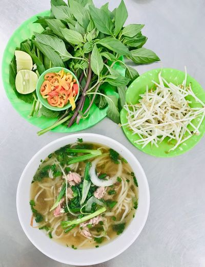 When in Vietnam... Noodle Soup Noodles Soup ShotOnIphone Vietnamese Food Vietnam Ho Chi Minh City Pho Noodles Pho Bo Pho Soup Food Food And Drink Freshness Healthy Eating Wellbeing Ready-to-eat Still Life Indoors  High Angle View Plate Bowl Close-up Pasta Meal No People Table Serving Size Directly Above Vegetable