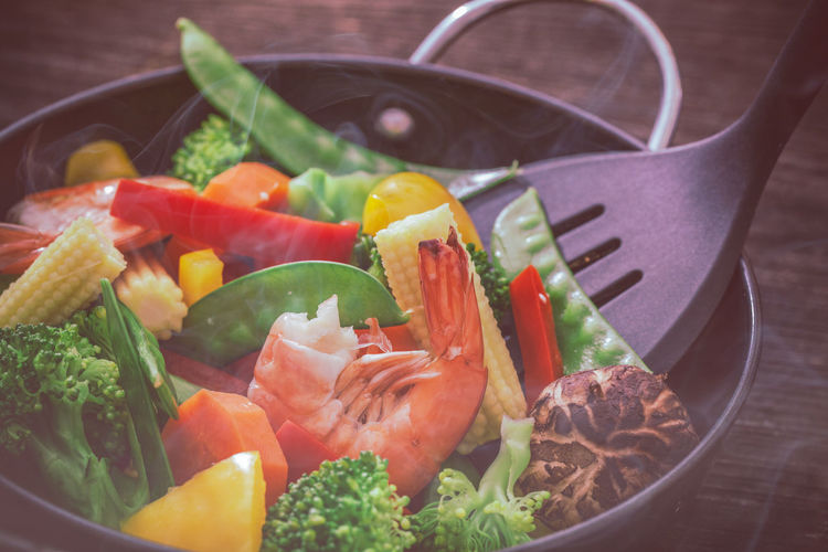 Close-up of vegetables in cooking pan on table
