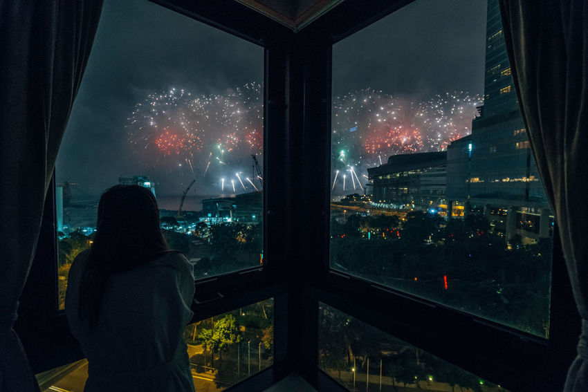 Architecture Arts Culture And Entertainment Building Exterior Built Structure City Cityscape Firework Firework Display Illuminated Indoors  Lifestyles Looking Through Window Men Nature Night One Person Real People Rear View Silhouette Sky Watching Window Winter Women