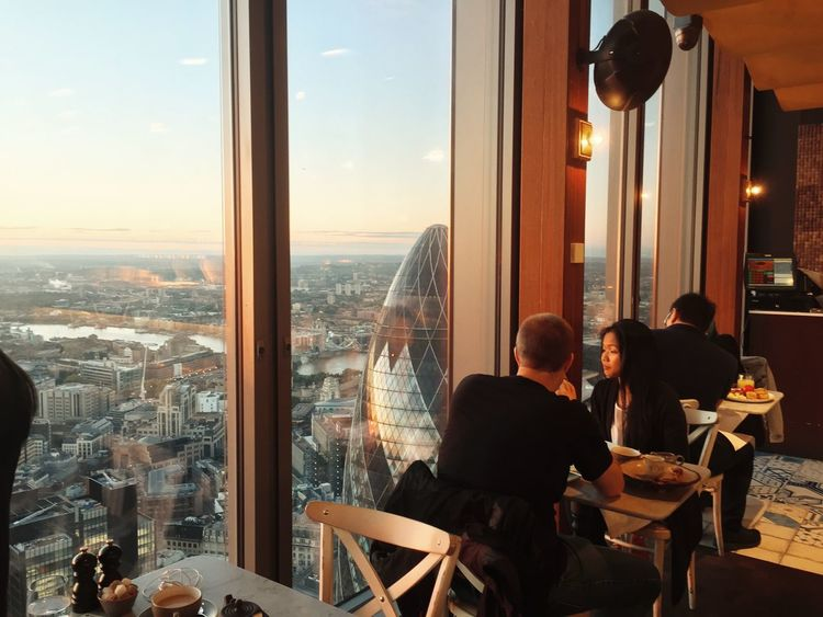 Sunset breakfast at Duck and Waffle Adult Business Businessman Chatting City Cityscape Gherkin Building Illuminated Indoors  London London Lifestyle Meeting Men People Restaurant Sitting Sky Teamwork The Gherkin Togetherness Two People United Kingdom Urban Skyline Window Women