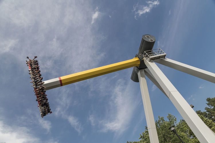 Architecture Built Structure Canadas Wonderland Cloud - Sky Communication Day Low Angle View Metal Mode Of Transportation Motion Nature No People Outdoors Pole Psyclone Sky Sunlight Sunny Tall - High Tree Wood - Material Yellow