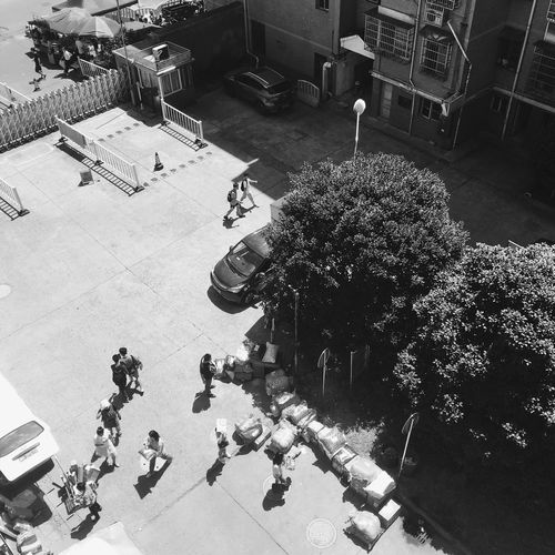 High angle view of people on street in city