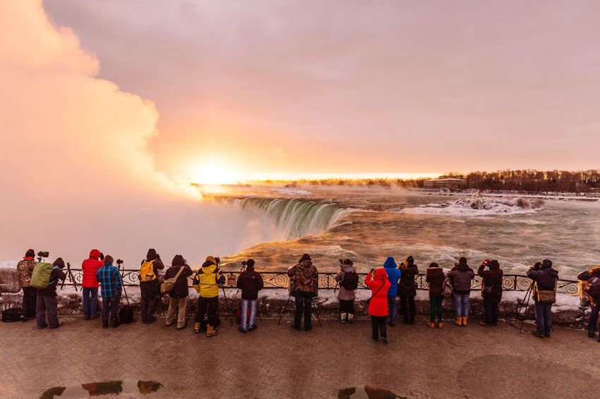 Early birds at the Horseshoe Falls of Niagara Falls. People Photographers Tourism Tourist Niagara Falls Canada Ontario Niagara River Horseshoe Falls Sunrise Cold Temperature Winter Cold Snow Holiday Travel Photography Niagara Parks Niagara Falls Canada Scenics EyeEm Selects Large Group Of People Water Sunset Heat - Temperature People Outdoors Crowd Colour Your Horizn