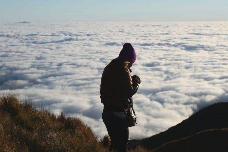 Woman standing against cloudscape