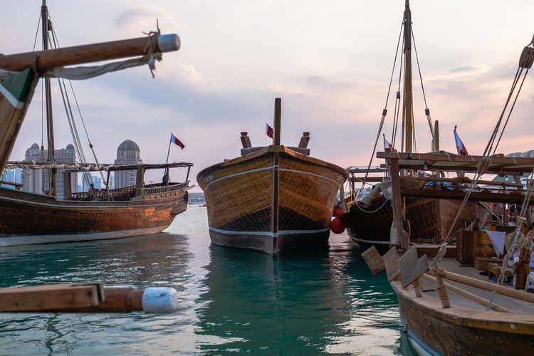 Traditional Bearings Festival, Doha, Qatar for fishing and pearl Katara Cultural Village Qatar Doha,Qatar Cultures Culture Hertitage Travel Tourism Arab Gulf Nautical Vessel Transportation Water Mode Of Transportation Cloud - Sky Nature Sunset Day Sea Sky Sailboat
