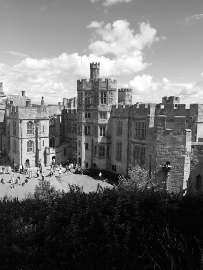 High angle view of people by warwick castle during sunny day