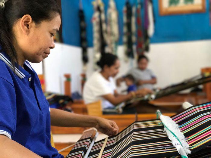 Women Weaving In Workshop