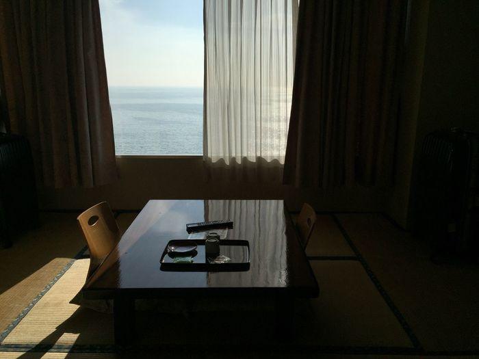 Sea seen through window at home