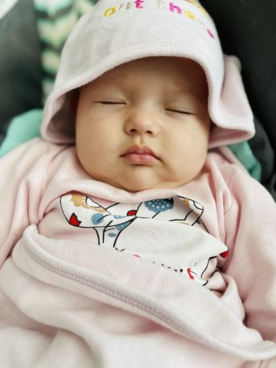 Close-up portrait of cute baby sleeping