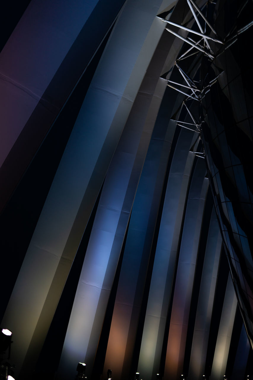 low angle view, built structure, architecture, building exterior, pattern, no people, sky, modern, building, city, glass - material, nature, night, outdoors, office, office building exterior, tall - high, window, reflection, illuminated
