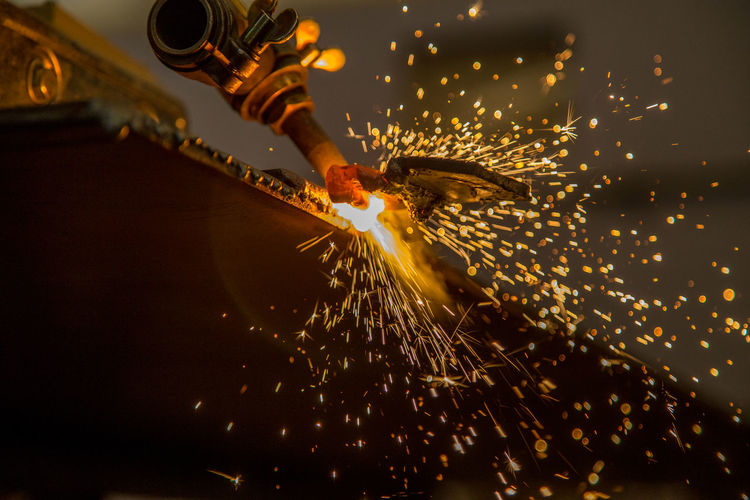 Industry Blurred Motion Burning Circular Saw Fire Fire - Natural Phenomenon Glowing Heat - Temperature Holding Illuminated Indoors  Industrial Equipment Industry Long Exposure Men Metal Industry Motion Occupation One Person Real People Spark Sparks Welding Working