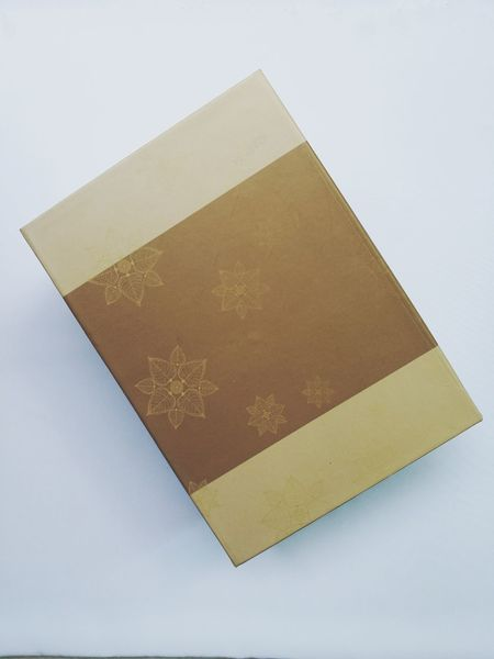 EyeEm Selects Paper box with gold color and beautiful flower pattern on brown stripe, as a elegance gift box. Business Finance And Industry Gold Colored Retail  No People Day Close-up Orthographic Symbolgift paper box flower pattern brown stripe