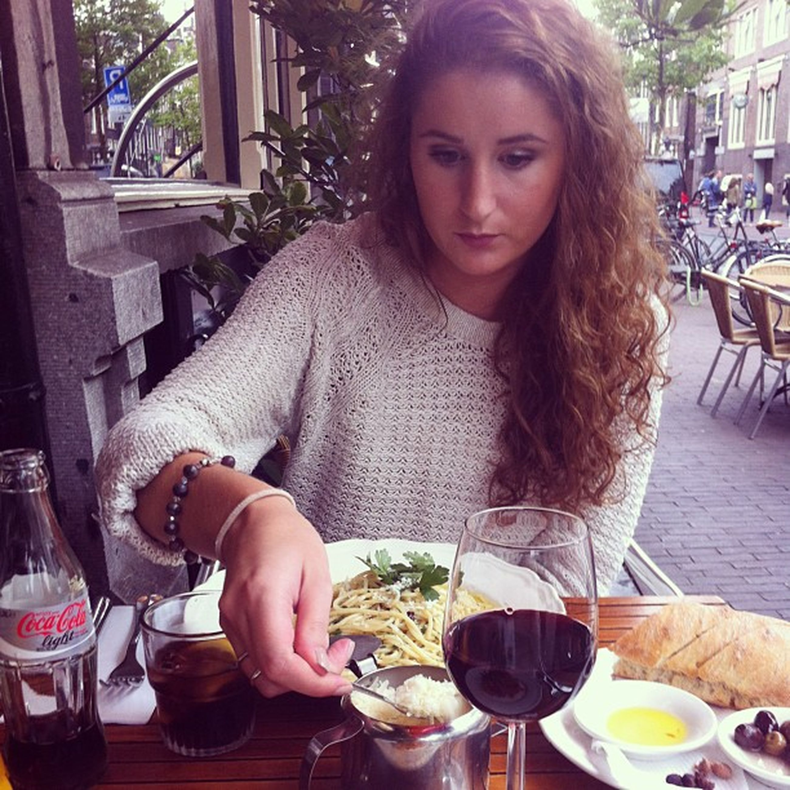 food and drink, person, table, lifestyles, sitting, drink, food, casual clothing, leisure activity, indoors, restaurant, chair, freshness, portrait, refreshment, front view, looking at camera, eating