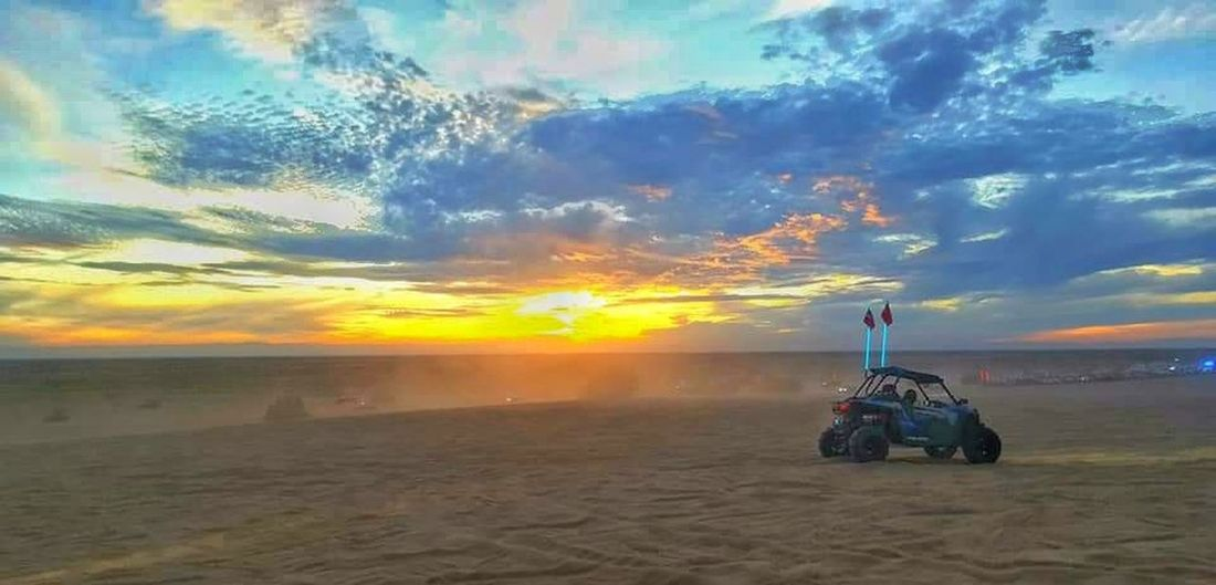 Another beautiful day in the desert. Sand Dunes Desrt Scenes Desert California Glamis Sand Dunes Brawley California Dune Buggy Adrenaline Junkie Adrelinrush Sunset Sand Outdoors Cloud - Sky Travel Destinations Sky Landscape Full Length Mini Vacation Beautiful Sunset Beautiful Scenic View EyeEmbestshots First Eyeem Photo Pictureoftheday EyeEm Selects EyeEm Gallery