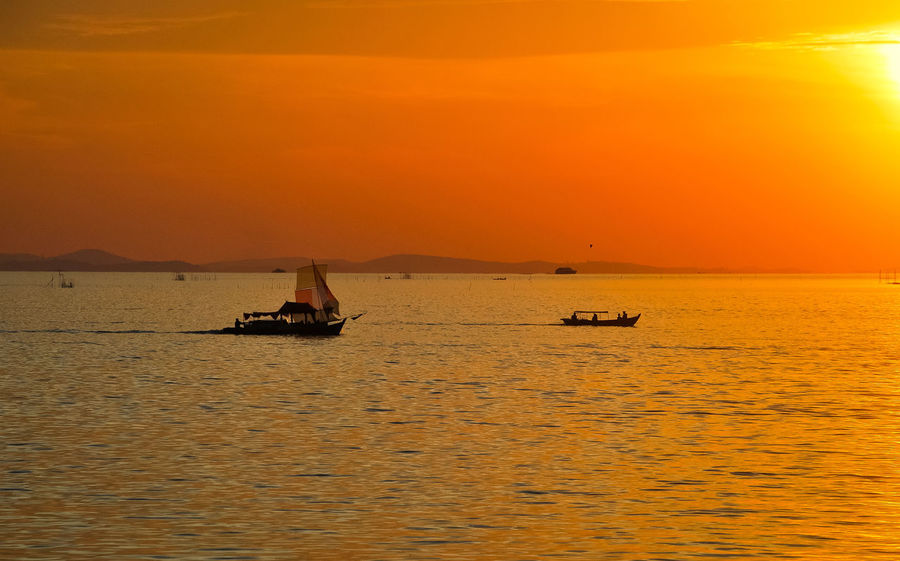Sunset Silhouette Sea Sailing Horizon Over Water PenyengatIslandSailing Boat EyeEmNewHere Eyeem Select Boats⛵️ Landscape Tourism Decorative Ship Penyengat Island Travel Travel Destinations Vacations Gold Colored Orange Color Sailing Ship EyeEm Selects Ship EyeEm Best Edits Tropical Climate Stockphoto