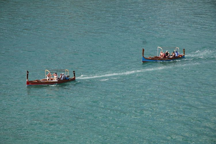 High angle view of people on boats sailing in sea