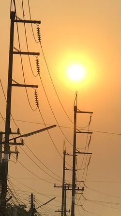 Sunset Sky Cable Electricity Pylon Power Line  Electricity  Technology Power Supply Connection Sun Low Angle View Nature No People Fuel And Power Generation Orange Color Silhouette Outdoors Pole Vertebrate Metal