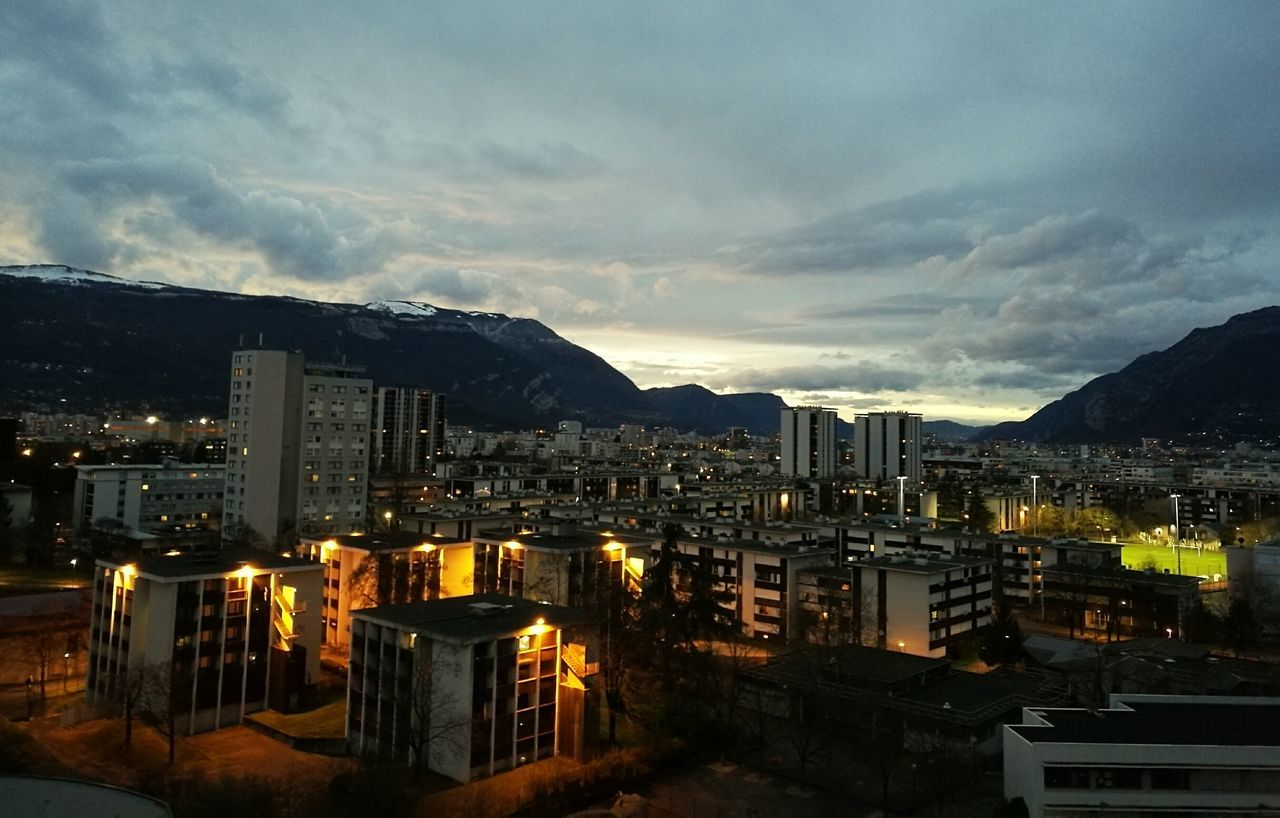 mountain, architecture, sky, cityscape, building exterior, no people, illuminated, built structure, cloud - sky, city, night, outdoors, nature