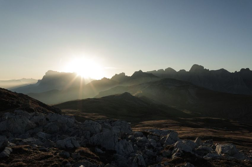 Sunrise on the mountain Schlern. Hiking Beauty In Nature Bright Clear Sky Environment Idyllic Landscape Lens Flare Mountain Mountain Peak Mountain Range Nature No People Non-urban Scene Outdoor Outdoors Rock Scenics - Nature Sky Sun Sunbeam Sunlight Sunrise Tranquil Scene Tranquility
