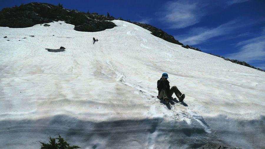 Full length of man sledding on snow covered mt lassen