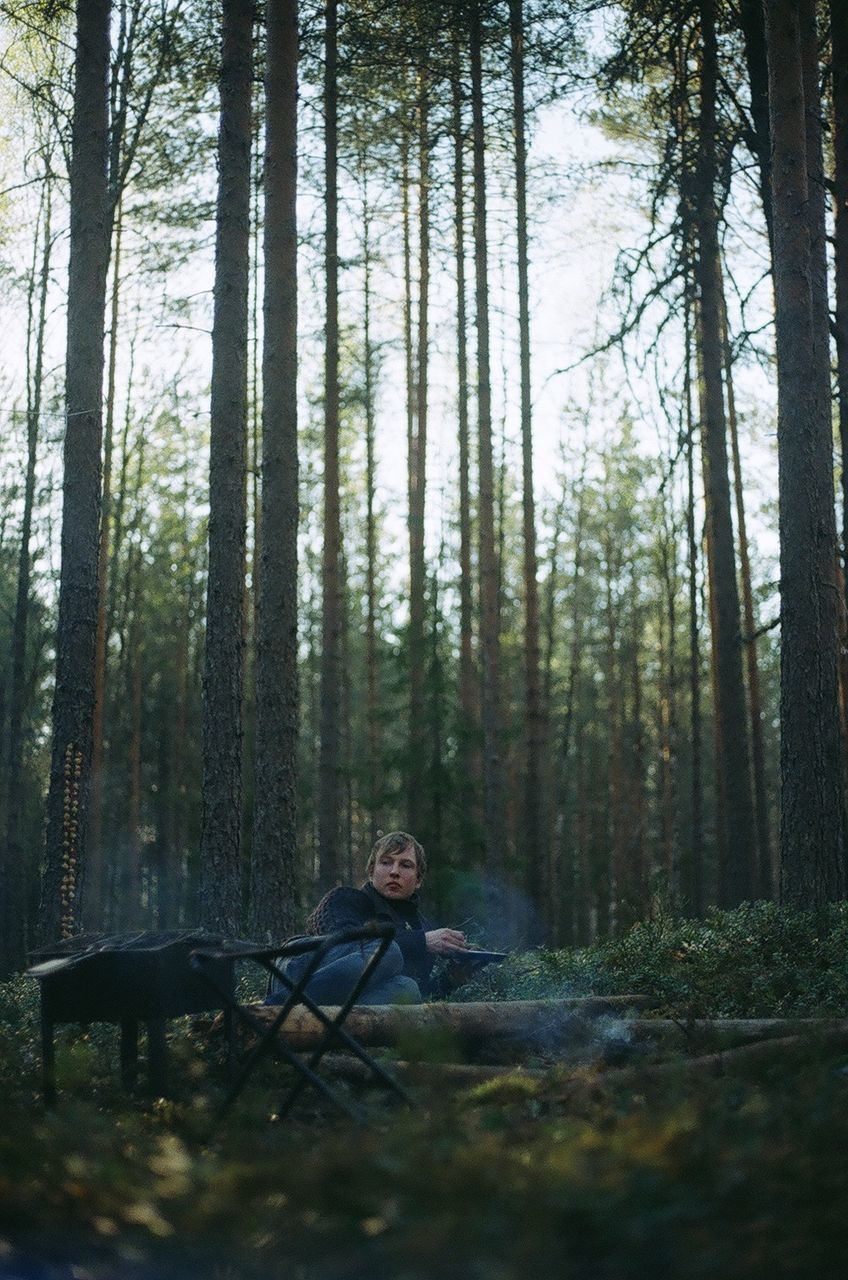 Man Sitting By Campire