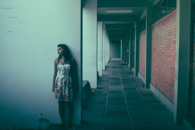 Woman Standing In Corridor Of Building