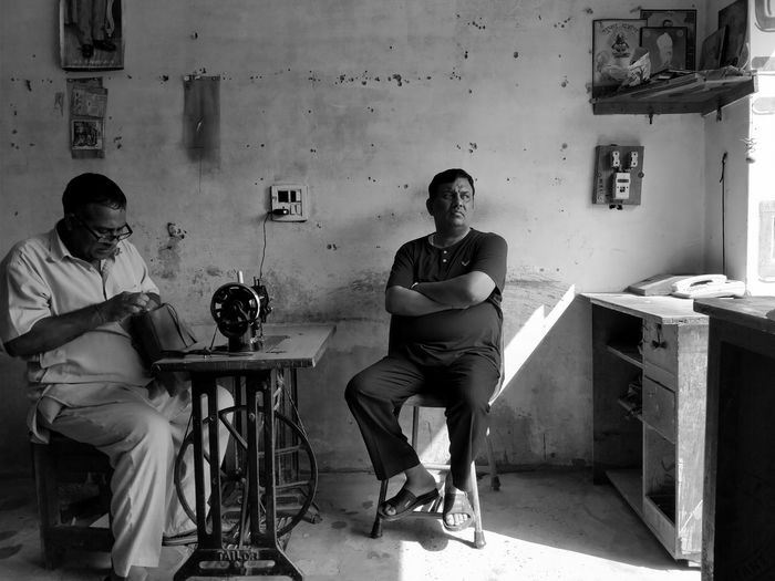 Lazy afternoons with tailor back in India! EyeEm Best Shots - People + Portrait The Week On Eyem EyeEm Gallery EyeEm Best Shots People Indoors  Blackandwhite Typicalsundays Two People Adult Men Human Body Part Adults Only Young Adult Only Men Day
