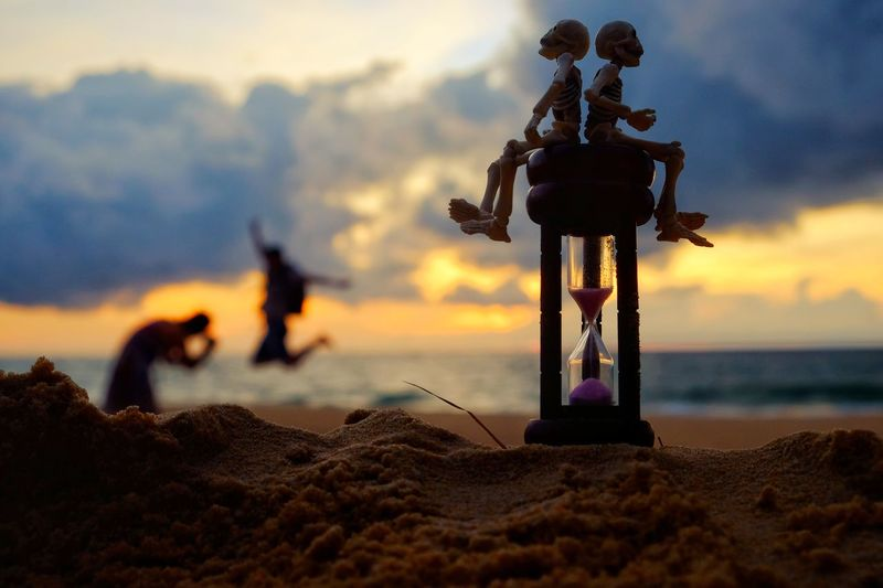 Sunset Sky Beach Silhouette Cloud - Sky Nature Water Day Jumping Season  Abstract Lifestyles Summer Cute Sitting Passing Mean Time Holiday Sand Toy Skeleton concept Hourglass Happiness Tourist