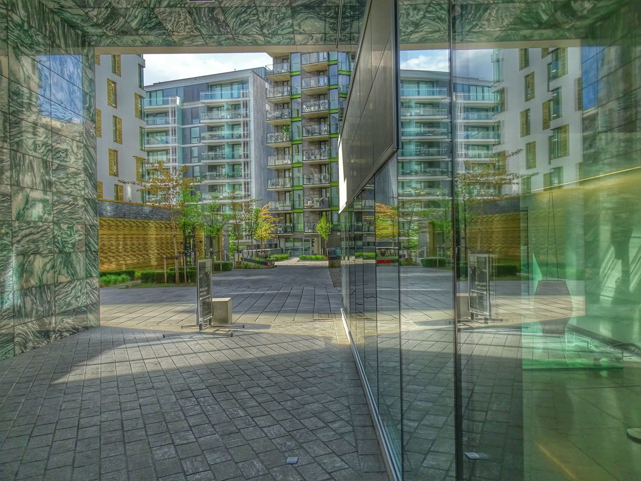 architecture, built structure, building exterior, no people, day, reflection, city, modern, window, outdoors, tree, growth, skyscraper