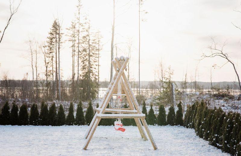 Gazebo on field against sky during winter