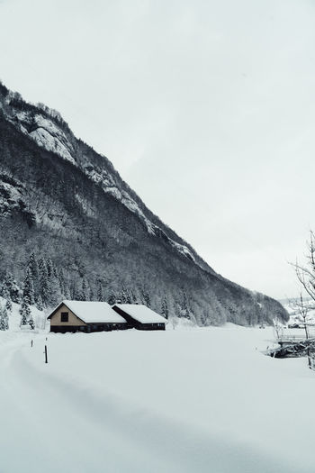 Cold Temperature Snow Winter Mountain Sky Beauty In Nature Scenics - Nature Nature Tranquility Tranquil Scene Day No People Landscape Environment Frozen Covering Non-urban Scene Snowcapped Mountain White Color Outdoors Cottage