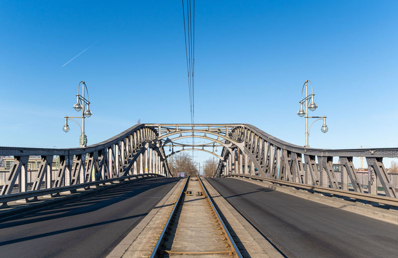 Railway bridge against clear blue sky