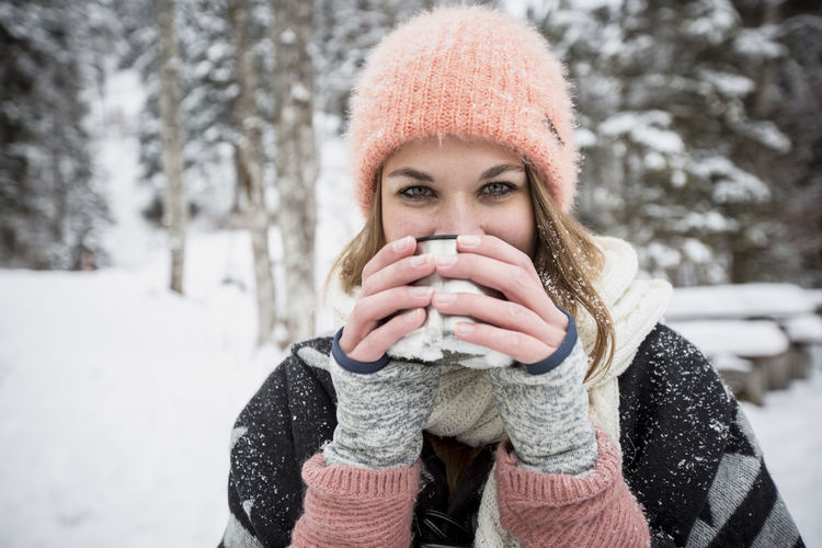 Portrait of mature man drinking coffee during winter