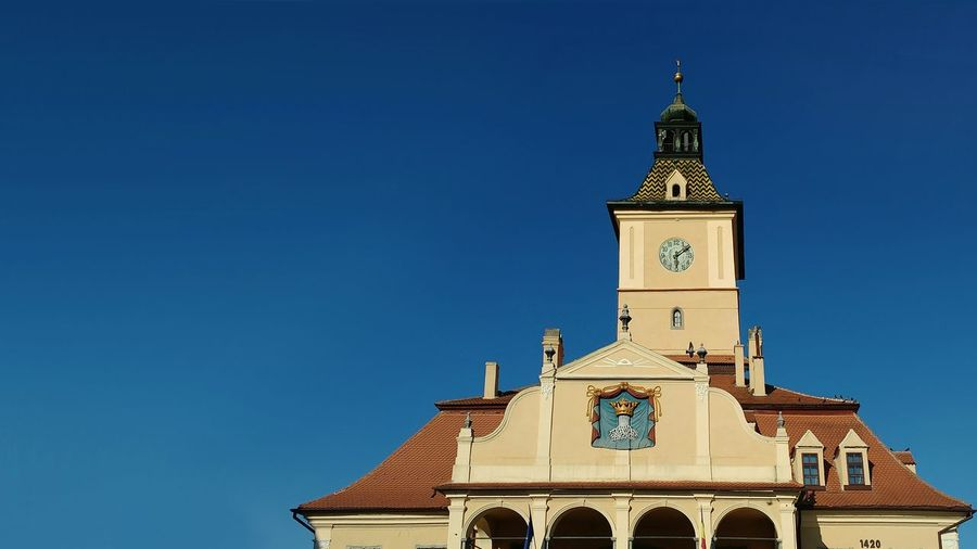 Low angle view of museum of history in brasov clear blue sky
