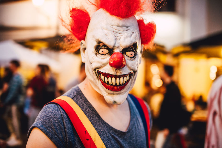 Carnival - Celebration Event Celebration Clown Costume Disguise Emotion Face Paint Fun Headshot Leisure Activity Lifestyles Looking At Camera Nightmare One Person Paint Portrait Scary Scary Face Smiling White Face
