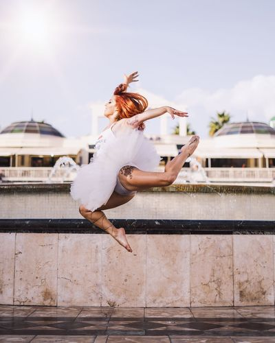 Fly Architecture One Person Built Structure Lifestyles Building Exterior Women Leisure Activity Real People Young Women Full Length Young Adult Sky Adult Nature Fashion Day Casual Clothing Jumping Outdoors Positive Emotion EyeEmNewHere