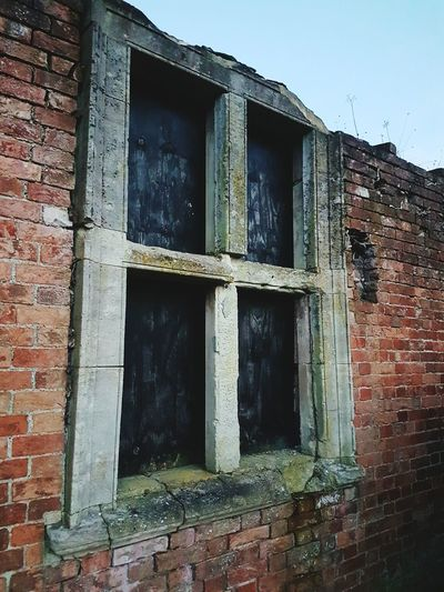 Squatters' rights Window Building Exterior Built Structure Architecture Outdoors Day No People Window Frame Brick Wall Dilapidated Rustic Tredegar House Newport National Trust 🇬🇧 Condemned Building Condemned Condemned House