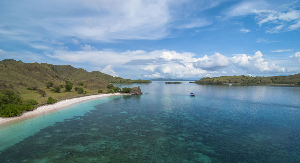 INDONESIA Beauty In Nature Blue Cloud - Sky Day Idyllic Lagoon Mountain Nature No People Non-urban Scene Outdoors Padar Island Reflection Remote Scenics - Nature Sky Swimming Pool Tranquil Scene Tranquility Turquoise Colored Water Waterfront